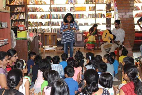 Children reading and listening in a story telling session