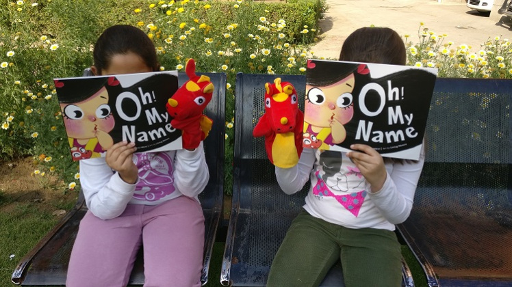 Cheryl and Arshiya reading the book with Dabi